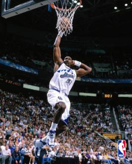 Karl Malone goes for a dunk